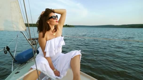 Wind blowing hair of happy female voyager on sailing boat