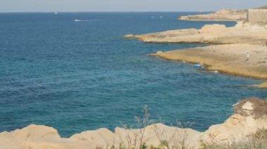 Nice rocky shore landscape. Sunny summer day.
