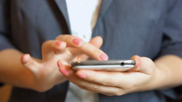 Businesswoman's hands typing text on smartphone, arranging meeting, shopping