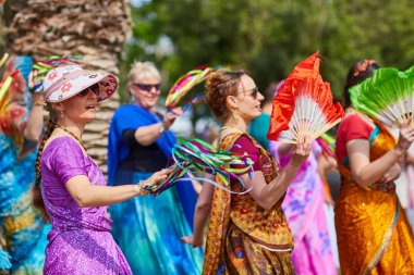 Ramat Gan - 15 April 2017: Happy people dance in the park during Hare Krishna festival in Ramat Gan, Israel stock vector