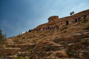 Jerusalem - 10.04.2017: Group of people trekking in the mountais