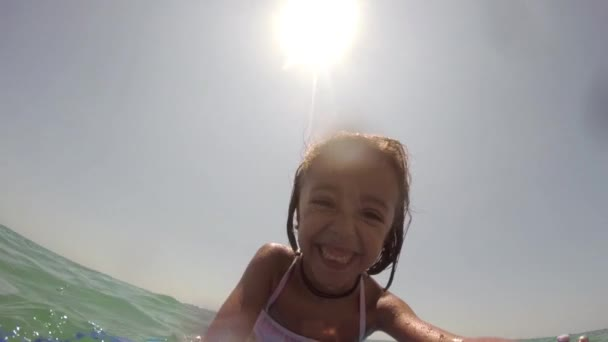 Girl happy on the surf board