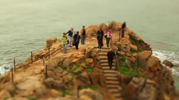 People walking at seacoast