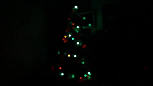 Christmas tree with decorations in darkness