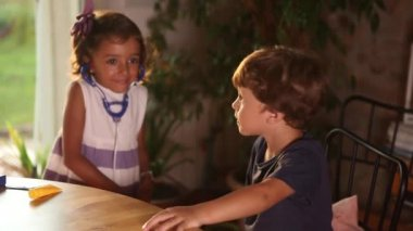 Girl and Boy Playing Doctors