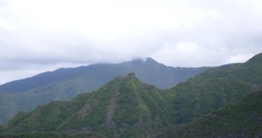 fast moving clouds over mountains tropical vegetation, amazing landscapes in misty background, huge big mountain background
