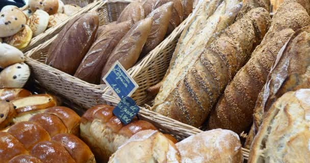 Breads and baked goods large assortment in bakery, shelves with fresh baked crispy bread, organic whole grain bio wheat foods boulangerie baguettes serving selling bread rustic display