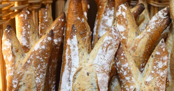 freshly made bread in bakery, whole grain organic loaves, beautiful delicious french style baguette handmade, golden brown baker display on the shop, crusty tender fresh homemade