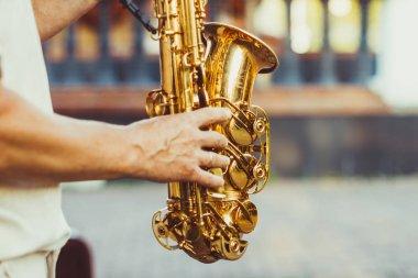Saxophonist plays on the street