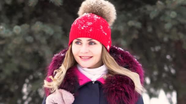a woman enjoys the snow