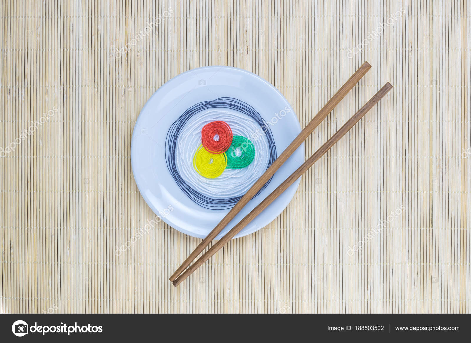 Colorful Strings In Form Of Sushi On White Plate And Sticks