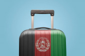 Suitcase with Afghan flag design travel Asia concept.