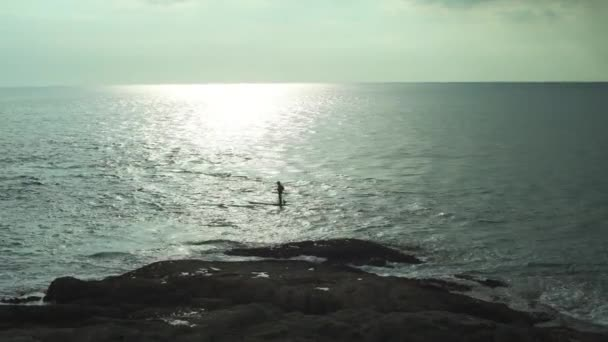 Man Stands On The Paddleboard On The Sea