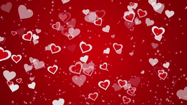 Piros hátteret, egy szívvel és izzó részecskék