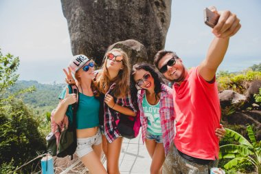 Happy hipster company of friends traveling around world, sightse