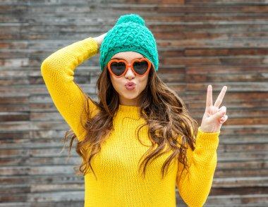 Beautiful brunette woman in sunglasses