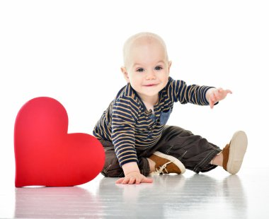 Happy baby with a red heart