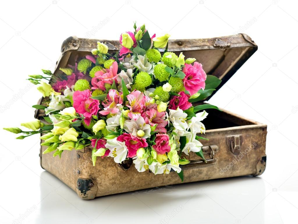 A bunch of beautiful flowers stock photo svetlanafedoseeva a bunch of beautiful flowers in an old shabby suitcase isolated on white photo by svetlanafedoseeva izmirmasajfo