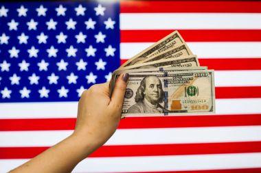 Man holding US Dollar bank note indicating market crash