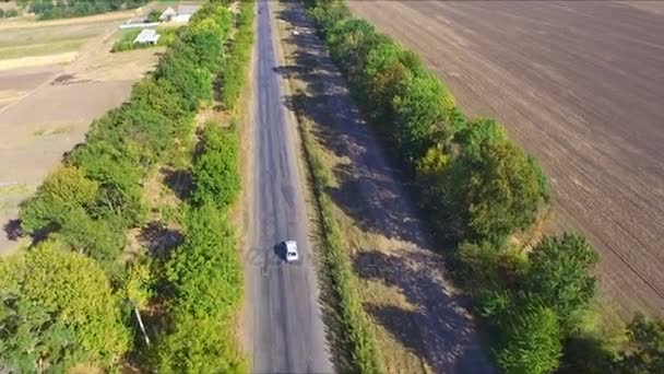 Aerial view electric car driving on country road, luxury car driving
