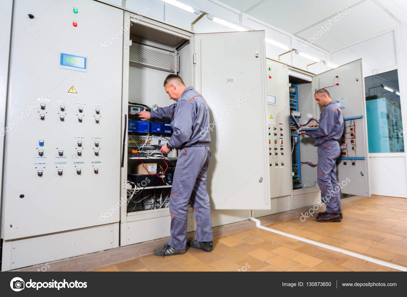 electrician testing industrial machine electrician builder engineer rh depositphotos com Bussmann Fuse Company Buss Fuse Guide
