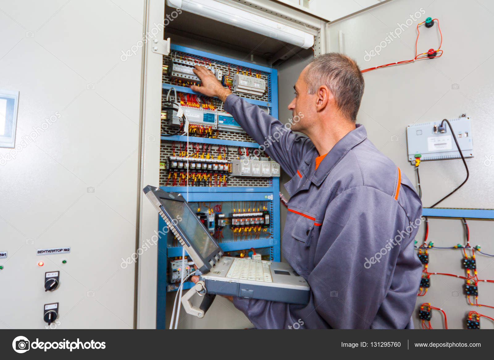 Electrician Testing Industrial Machine Builder Engineer Fuse Box Electrical Screwing Equipment In Male
