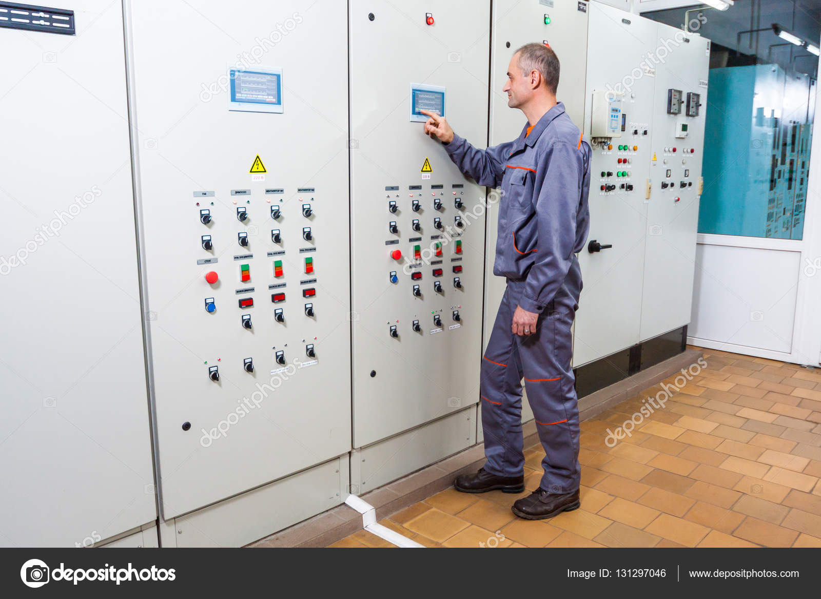electrician testing industrial machine, electrician builder engineer ...