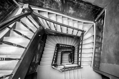 spiral staircase, antique wooden staircase,Old Spiral Staircase,Upside view of a spiral staircase,Black and white photo