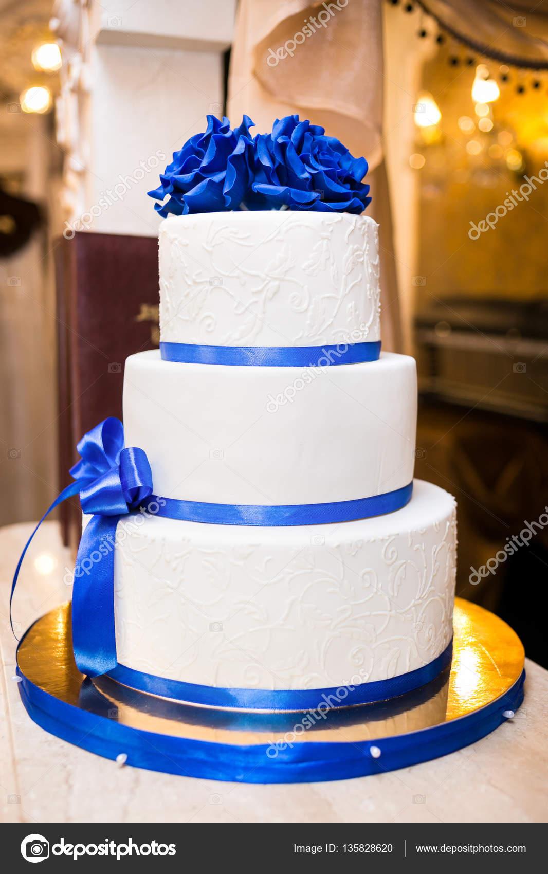 wedding cake, festive multi-storey cake, a cake in white and blue ...