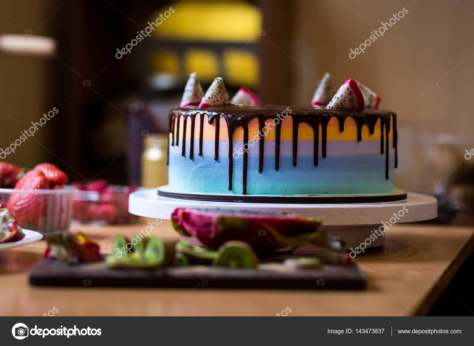 cake with multicolored shortcakes decorated by dragon fruit with