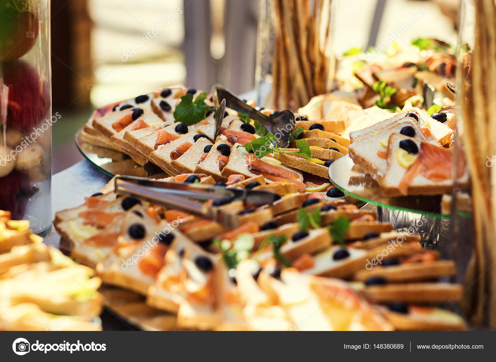 Buffet table canape with salmon sandwiches snacks for Canape table