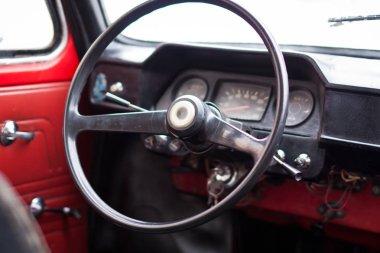 Vinnitsa, Ukraine - 09 February 2013.ZAZ 968A concept car.Red old car ZAZ.Inside the car,steering wheel close up,interior of the car, logo ZAZ 968.Retro car