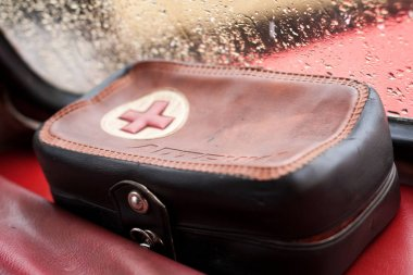 Vinnitsa, Ukraine - 09 February 2013.First-aid kit,medicine bag, surgical bag in ZAZ 968 retro car