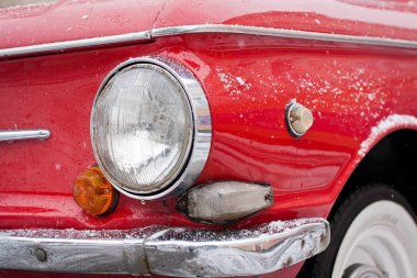 Vinnitsa, Ukraine - 09 February 2013.Lights,outside of the car ZAZ 968A,retro car, old soviet red car