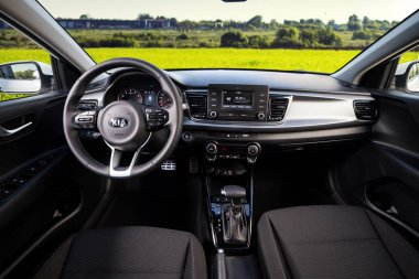 Vinnitsa, Ukraine - May 19, 2017.KIA Rio concept car.Inside the car,steering wheel,interior of the car.Front of the car, logo KIA Rio,showroom.Presentation of the new model car - KIA Rio