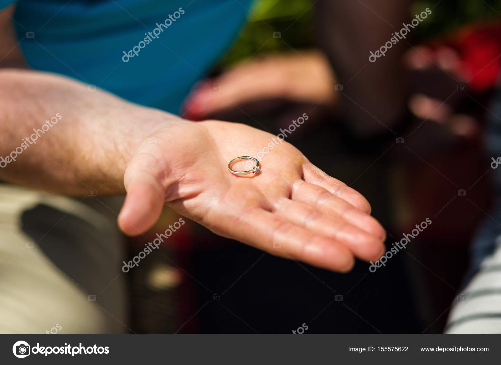 man holding in his hand a ring, the guy gives the girl a ring, a ...