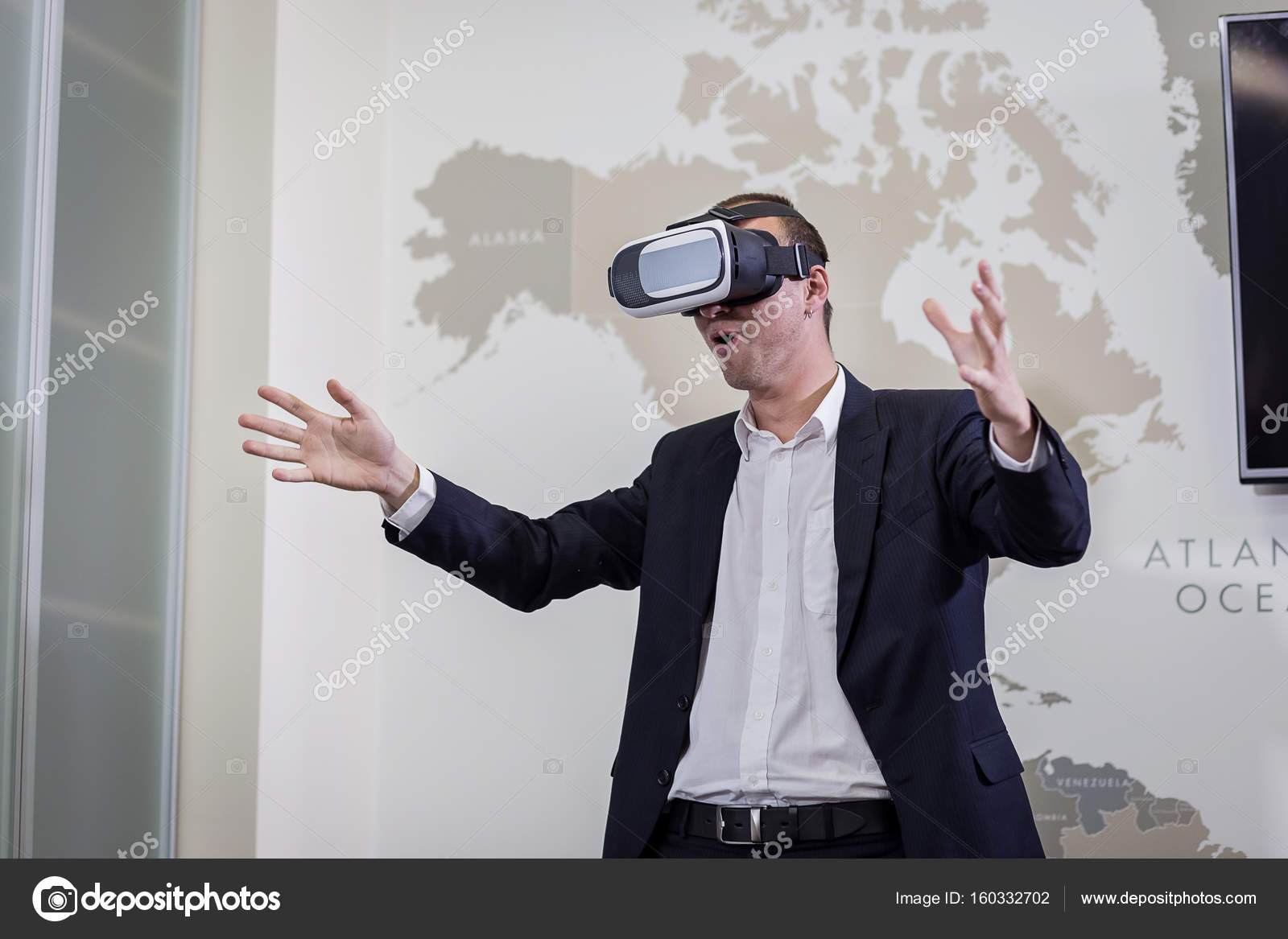 Man wearing virtual reality goggles,Businessman making