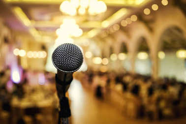 Microphone. A microphone on stage. A pub. Bar. Restaurant. Classic. Evening. Night show. European restaurant. European bar. American restaurant. American bar.