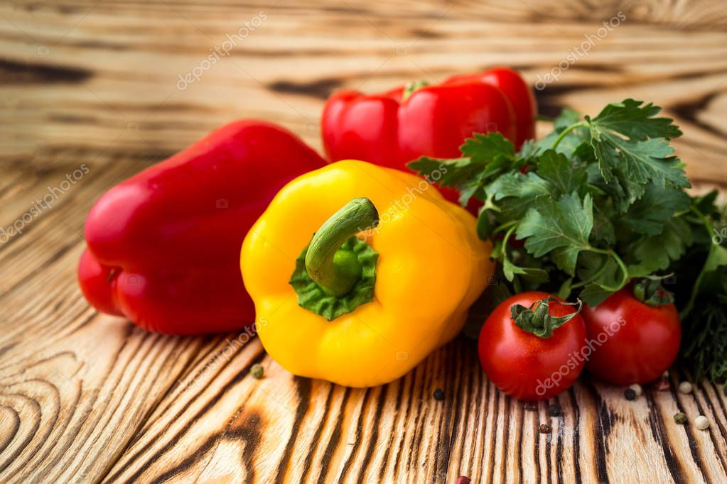 Composition with assorted raw organic vegetables such as tomatoes, sweet peppers, herbs. Detox diet