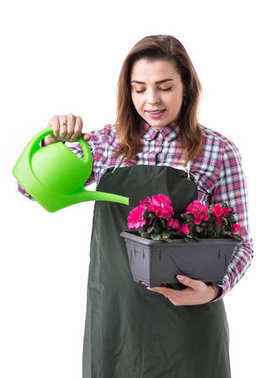 woman professional gardener or florist in apron holding flowers in a pot and gardening tools  isolated on white background