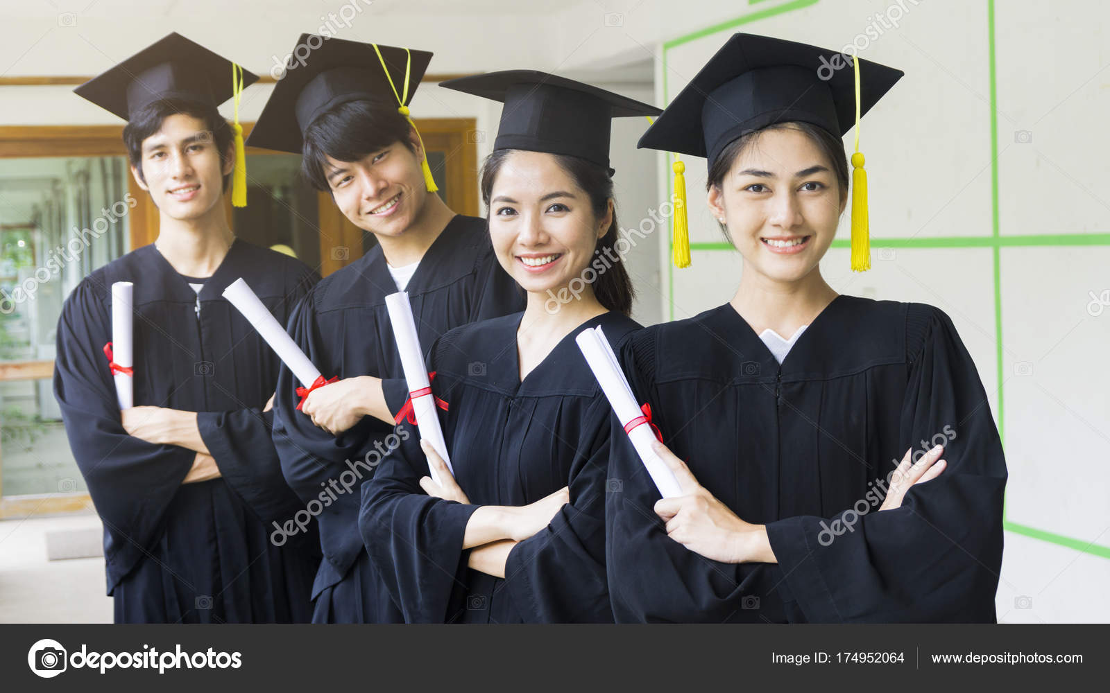 the people students man and woman with black graduation gowns hold ...