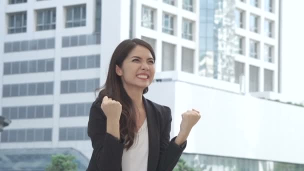 business woman stand with feeling confident and success with happy emotions outdoors
