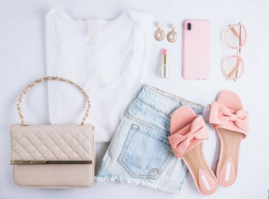 Female clothes and accessories with white t-shirt, jeans, sunglasses, lipstick, pink shoes, earrings and smartphone on white background. Flat lay. Top view stock vector