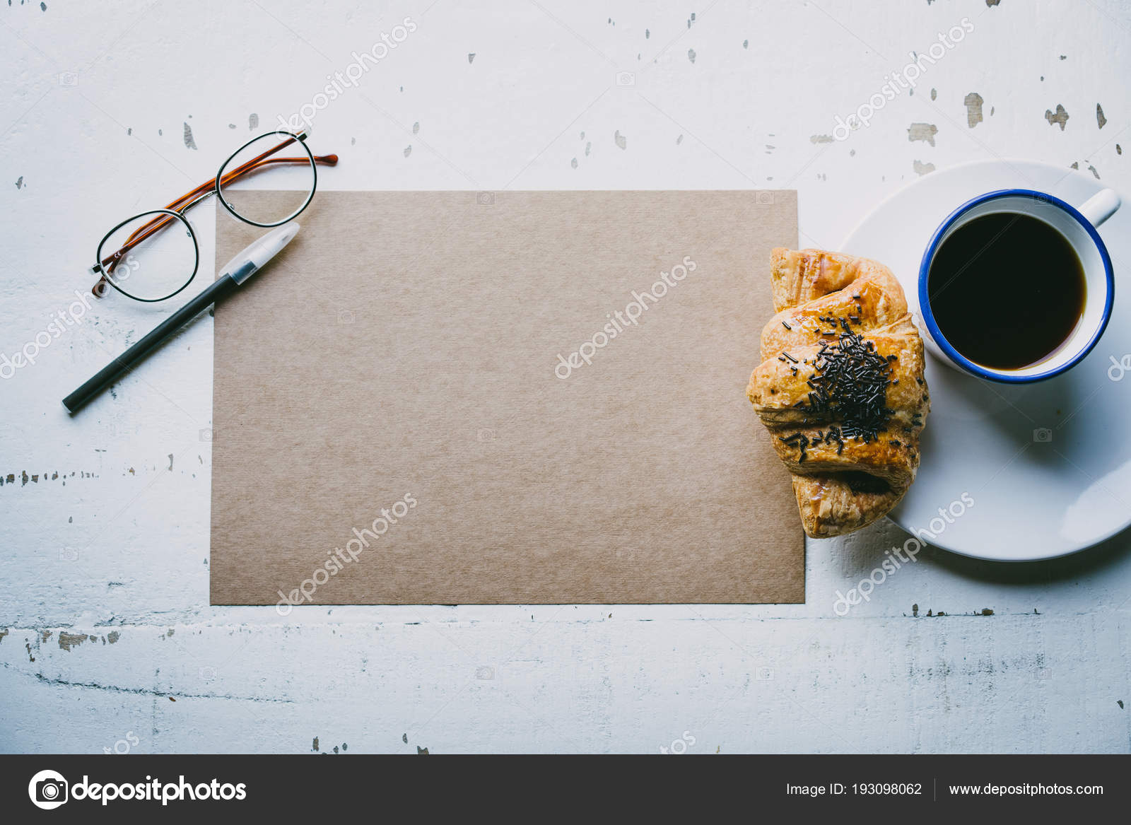 Mockup Blank Craft Sheet Of Paper Pen Eye Glasses And Morning Coffee Cup With Croissant On White Wooden Desk Business Background For Letter
