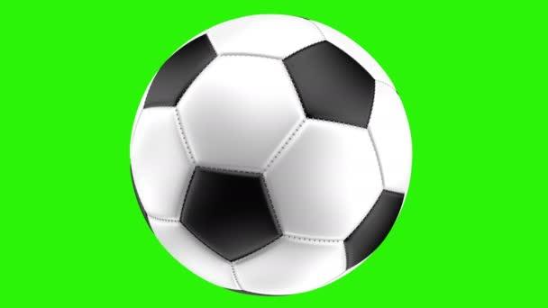 Izolované realistické fotbalový míč na zeleném pozadí se otáčí, vykreslování 3d objektů