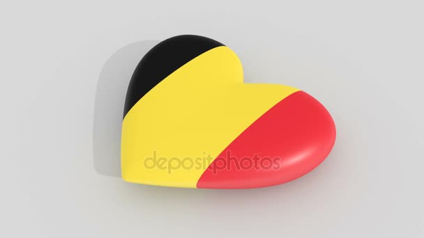 Pulsating heart in the colors of Belgium flag, on a white background, 3d rendering, loop