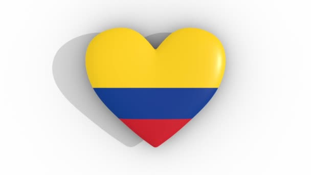 Pulsating heart in the colors of Colombia flag, on a white background, 3d rendering top, loop