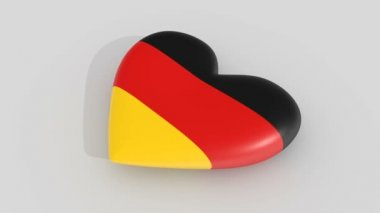 Pulsating heart in the colors of Germany flag, on a white background, 3d rendering side.
