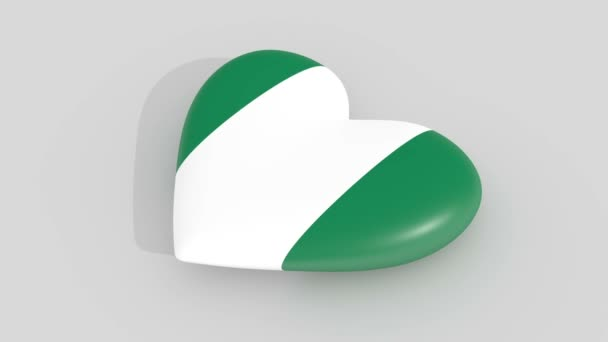 Pulsating heart in the colors of Nigeria flag, on a white background, 3d rendering side.