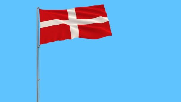 A zászlórúd, csapkodott a szélben, tiszta kék háttérrel a Szuverén Máltai Lovagrend zászlaja.